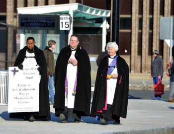 Ashes in the street welcomes Christian season of Lent for busy commuters